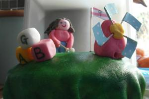 A layered Mini-golf cake for G's 9th