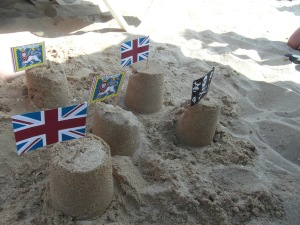 One of the many sandcastle creations M built during the week