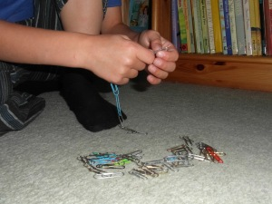 Creating and then dismantling paper-clip chains