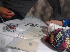 M and Daddy putting together some new Star Wars Lego