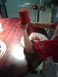 Adding the GF tomato sauce to the base